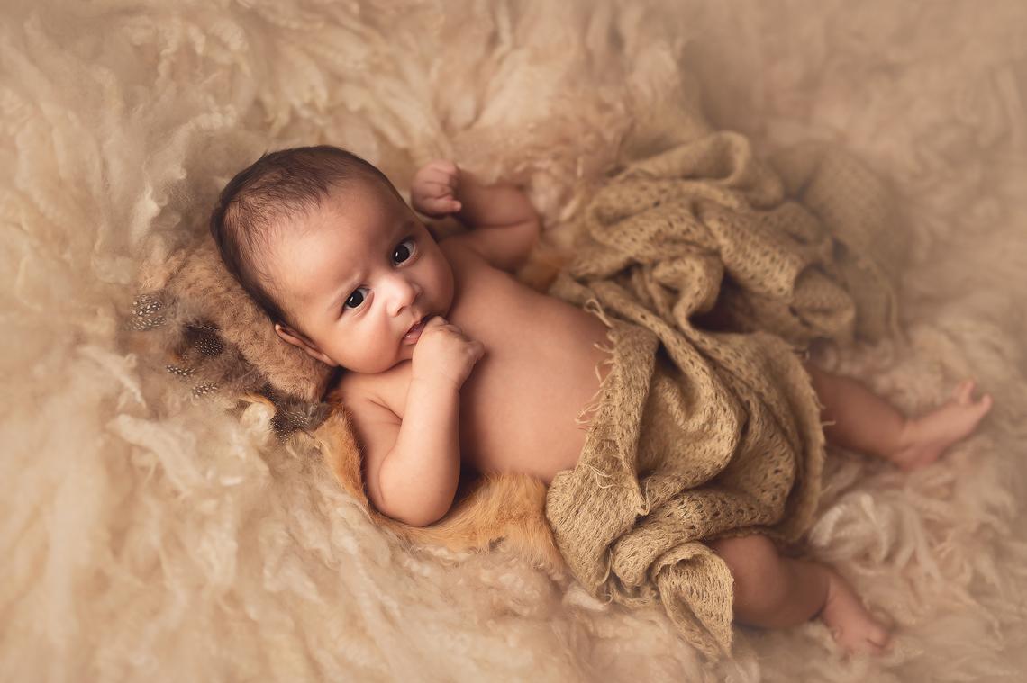 baby boy on the light fur