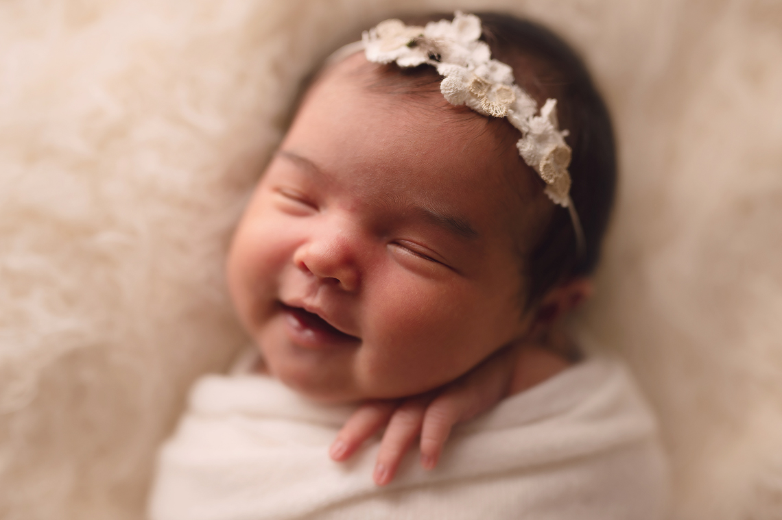 newborn baby girl portrait smiling