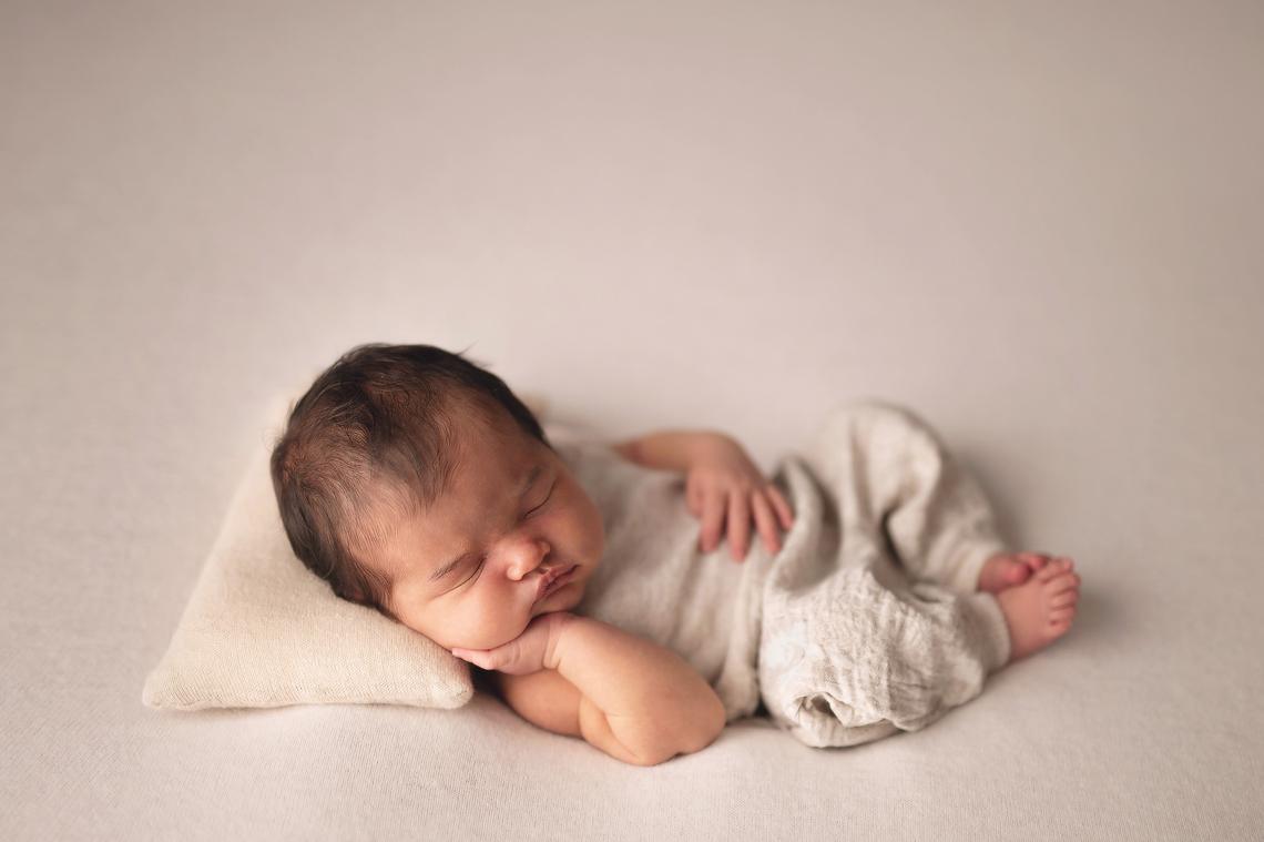 newborn baby girl wearing cute beige handmade outfit