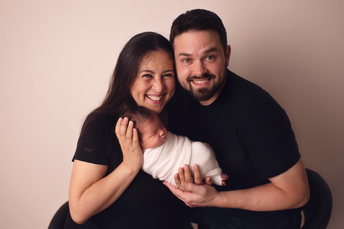 parents holding a newborn baby